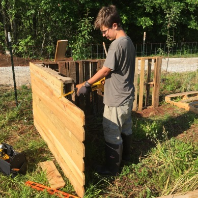 Adding slats to pallet shelter, to cut draft.