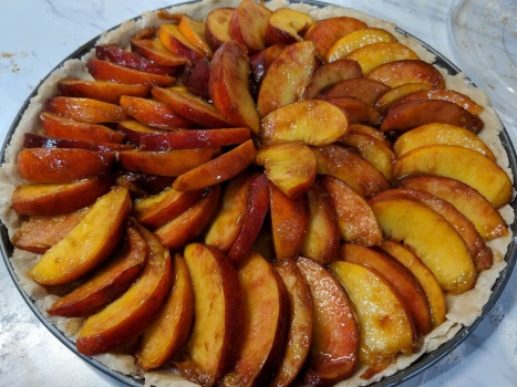 Arrange those tasty soaked peaches in a florette pattern.